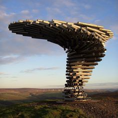 musical sculpture outside burnley, england by tonkin lu...  when the wind whips though the steel pipes..it sounds like a whale song...