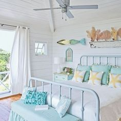 Sculptor/Metal Artist Chase Allen's small 3' sea foam green mermaid with blonde hair works well with this coastal bedroom decor.