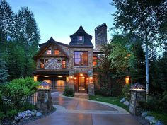 Aspen, Colo.  This beautiful Arts & Crafts home is bursting at the seams with log and stone accents. Outside, the entryway is flanked by stone columns with built-in lighting