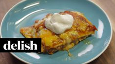 How to Make Enchilada Lasagna | Delish: Making your enchilada sauce from scratch is easy and so worth it.