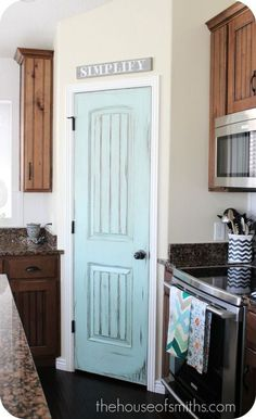 Distressed aqua blue pantry door