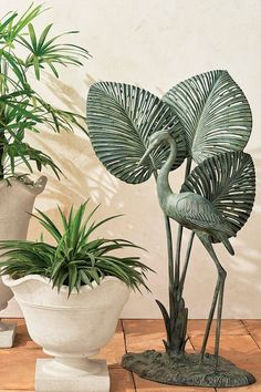 Crafted of cast aluminum and finished with a hand-applied verdigris powdercoat, this elegant sculpture features a majestic heron that brings a touch of tropical sophistication to any outdoor space. Retractable Hose, Angel Fish, Organic Form, Metallic Blue, Wall Sculptures, Heron, Green And Gold, It Cast, Tropical
