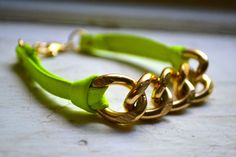 gold curb link chain bracelet with neon green genuine leather ties