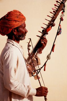 MUSICAL INSTRUMENTS: Rawanhattha - Said to be one of the oldest known string instruments, it is rare to find it now-a-days. Made of a long piece of bamboo set into a dry coconut, it has one main playing string and many others for a drone. It is played with a bow and is still popular in Rajasthan, especially with the Bhopa community.