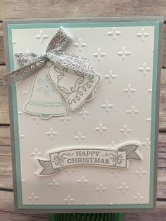 "This Christmas card uses Stampin' Up!'s Seasonal Bells stamp set and Bell Punch (bundled together for a discount!).  We embossed the background with the Sparkle embossing folder.  The ribbon is the Silver 3/8"" Glitter Ribbon.  The greeting is die cut with the Bunch of Banners Framelits.  I love how Stampin' Up! makes images from new stamp sets match dies we already carry!  #stamptherapist #stampinup  www.stampwithjennifer.blogspot.com"