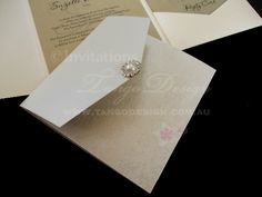 Square pocketfold for DIY invitations by www.tangodesign.com.au #ivory #wedding #invitations #bling