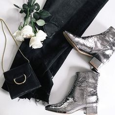 Silver boots, frayed hems, and a chic bag.