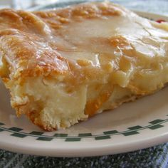 Breakfast Cheese Danish  so easy 2 cans ready to use refrigerated crescent rolls  2 8-ounce packages cream cheese  1 cup sugar, 1 t vanilla extract. 1 egg, 1 egg white  Oven 350, grease baking pan. Lay a pack of crescent rolls in the pan and pinch together. Beat cream cheese, sugar, vanilla, and egg until smooth. Spread mixture over crescent rolls and top with the other crescent roll, and brush with egg white. Bake 35-45 minutes until top is golden brown. Top with glaze after cool.