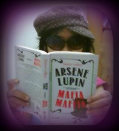 Miss Julie Medikawati and her Arsene Lupin's novel