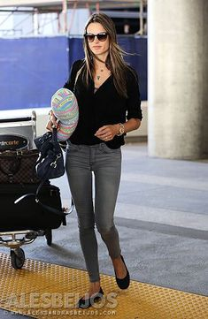 ALESSANDRA AMBROSIO ARRIVAL AT LAX INTERNATIONAL AIRPORT - SEPTEMBER 25, 2013