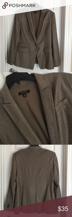 Ann Taylor Lightweight Virgin Wool Blazer. Size 14 Ann Taylor Lightweight Virgin Wool Pinstripe Blazer. Size 14. Shades of Light Brown and tan. Shell is 55% virgin wool, 43% rayon, 2% Lycra spandex. Lining is 94% polyester, 6% spandex. Dry clean. Ann Taylor Jackets & Coats Blazers