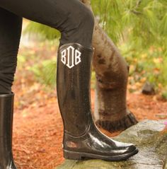 You could do this with cheap rubber rain boots from Walmart and use a cricut for your monogram