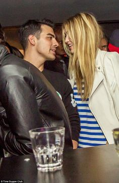 Cosy and close: Despite denying they are dating, Gigi Hadid and Joe Jonas looked very much like a couple as the spent back to back nights at the Time Supper Club in Montreal, Canada, over the weekend