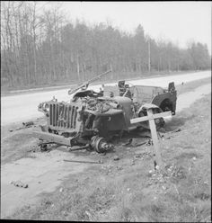 The grave of a British soldier who was killed during Operation Market Garden in 1944, lies alongside the wreckage of his jeep near Arnhem - 18th April 1945.