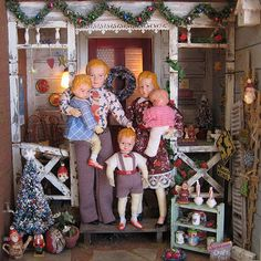 the most darling Christmas dollhouse