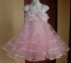 """Pink Petticoat...starched these with sugar so they would stand way out!  These """"crinolines"""" were a problem in classrooms, because when girls wearing them walked down the aisles things were knocked off the desks!  When I was in the 5th - 7th grades, more than 3 peticoats like this was not allowed.  (The ones I remember had elastic around the waist...half-slips...no straps."""