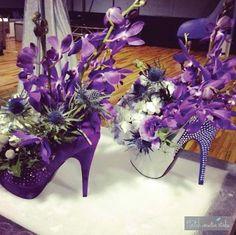 High heel centerpiece > floral arrangement. Beautiful in purple an white!