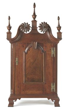 A CHIPPENDALE CARVED CHERRYWOOD SPICE CABINET PROBABLY MONTGOMERY COUNTY, PENNSYLVANIA, CIRCA 1765