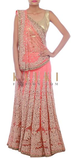 Buy Online from the link below. We ship worldwide (Free Shipping over US$100) http://www.kalkifashion.com/peach-lehenga-saree-embellished-in-thread-embroidery-only-on-kalki.html