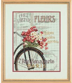 Dimensions Parisian Bicycle - Cross Stitch Kit. Imagine peddling your bicycle down a Paris street, passing the colorful shops along the way. This design is stit