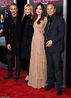 Family night out: Dakota Johnson was joined by her parents Melanie Griffith and Don Johnson, and her half-brother Jesse Johnson, at the premiere of How To Be Single in New York on Wednesday night