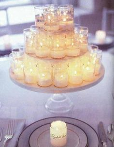 add ribbon, lace, pearls to the candle holders. use near escort cards or on an accent table :) .... this will be great if we decide not to have an actual cake