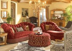 I love that is very Victorian yet still cozy.  Make me want to curl up on the chaise with cup of rose tea!