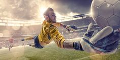 Football Goalkeeper Diving To Save Ball During Soccer Match – Foto