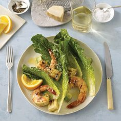 This Caesar salad gets its zest from grilled shrimp marinated in an orange-garlic mix and homemade croutons brushed with a sour-orange and garlic oil.