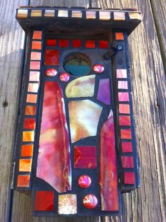 Oh! Like the dramatic look with dark grout, bright stained glass. Mountain Lily Farm