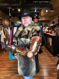 Viscount Eastman Wesley winter travel ensemble. Siberian Wolf coat with mechanical arm by Dr. Gerehaken's Laboratory. Styling and concept by VEW Steampunk Designs.