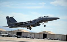 F-15E Strike Eagle assigned to the 4th Fighter Wing, Seymour Johnson Air Force Base, N.C., takes off during Red Flag 14-3 at Nellis Air Force Base, Nev., July 15, 2014. Red Flag is a realistic combat training exercise involving the air, space and cyber forces of the U.S. and its allies, and is conducted on the vast bombing and gunnery ranges of the Nevada Test and Training Range. (U.S. Air Force photo by Staff Sgt. Siuta B. Ika)