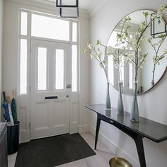 Narrow hallway entry ideas white hallway with contemporary console table and large round mirror narrow entry . White Hallway, Modern Hallway, Hallway Mirror, Hallway Console Table, Ikea Hallway, Hallway Table Decor, Hallway Flooring, Long Hallway, Entry Hallway