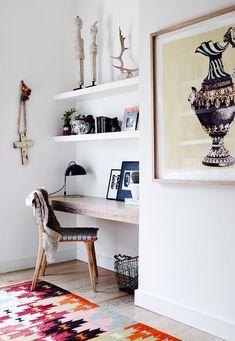 white built-in shelving + woodtop desk
