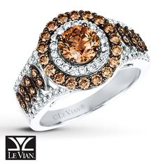 The delectable center of this striking ring from Le Vian® is a 1-carat Chocolate Diamonds® encircled in sparkling Vanilla Diamonds® and additional Chocolate Diamonds®. Two rows of more Chocolate Diamonds® form the center row, while additional Vanilla Diamonds® line the edges to complete the look. Fashioned in 14K Vanilla Gold® the ring has a total diamond weight of 2 carats.