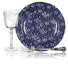 "Bold tableware set with ""Buttercup"" glass pattern from Fostoria, ""Buttercup"" silver pattern from Gorham, and ""Calico Blue"" china pattern with periwinkle blue floral chintz on navy from Staffordshire."