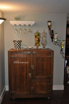 Antique Ice Box turned into a Bar...great for storage and out of the way drink station
