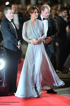 """The Duchess of Cambridge attended the premier of Spectre wearing a bespoke Jenny Packham gown. She accessorized with her Jimmy Choo """"Vamp"""" sandals, Jenny Packham """"Casa"""" clutch, and borrowed her mom's Robinson Pelham """"Pagoda"""" earrings."""