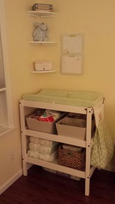 Changing table is also from Ikea. Shelves Lowes.  Room for cloth diapers, disposable diapers, wipes etc.