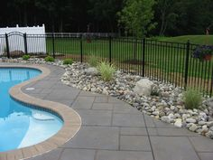 Landscaping around Pool with Rocks Five Creative Ideas for Landscaping With Rocks Landscaping around Pool with Rocks. Landscaping around pool or water feature with rocks is a great way to give your… Landscaping Around Pool, Swimming Pool Landscaping, Pool Fence, Swimming Pool Designs, Fence Landscaping, Landscaping Contractors, Fence Around Pool, Landscaping Design, Stone Around Pool