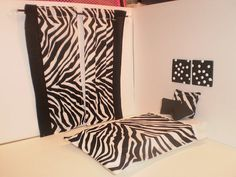 Zebra print bedding, curtain and decor