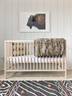 In love! I want the inspiration of the room derived from this picture. The crib is perfect and also in love with the rug. Must have cool blanket like this to hang on the crib.