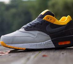 Nike Air Max 1 – Pale Grey / Dark Charcoal – Black – Laser Orange