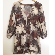 "Beautiful Brown Floral Kimono Blouse This is a kimono style blouse with large flowy sleeves. It is a closed front with a tie at bust. Pair this semi sheer top with a brown or tan cami for a cute stylish look. It's long so looks great with leggings too! Approximately 28"" in length. New York & Company Tops Blouses"