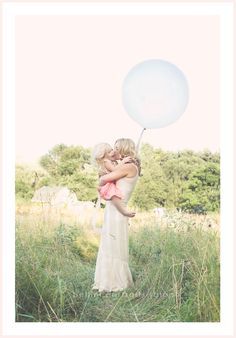 mom and daughter, precious. love the lighting through the balloon
