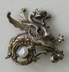 Victorian Griffin Freshwater Pearl Sterling Watch Pin/Brooch \\ This fun Victorian brooch/watch pin features a griffin set with a freshwater pearl.