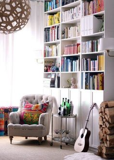 IKEA Billys 10 Ways: The World's Most Versatile Bookcase. i like the idea of a floor to ceiling bookcase made with these IKEA shelves. Doors are a nice way to hide clutter. Billy Ikea, Ikea Billy Bookcase Hack, Ikea Shelves, Billy Bookcases, Billy Bookcase With Doors, Ceiling Shelves, Tall Shelves, Ikea Storage, Closet Storage