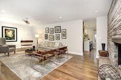 Mid-Century Modern renovation. Banco and Grohe plumbing fixtures, custom light fixtures, custom window treatments, Electrolux appliances in newly redone kitchen, hardwood floors and tile throughout.