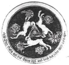 """Hasendrei/Hare trinity -- shooting-target in the Deutsches Jagdmuseum. Legend: """"Drei Hasen uind der Ohren drei, und doch hat jeder ihrer zwei"""" [three hares and their three ears, and yet each has its two] dia: 65.5cms"""