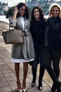 Meghan Markle wearing Burberry Belted Wool Wrap Coat, Aquazurra Matilde Pumps and Celine Ring Bag